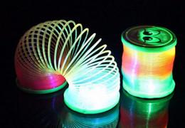 Wholesale Hot Rod Cartoons - 12pcs lot 2017 Hot lantern rainbow circle cartoon toys design Flash plastic spring coil With the rod and rope luminous lighting