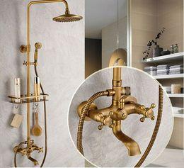 Wholesale Antique Bathroom Wall Faucet - Bathroom Antique Brass Shower Faucet Rainfall Shower Head Bathtub Mixer Tap With Bath Shelf