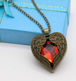 Wholesale Ruby Faceted Necklace - 2017 European and American style tide part retro peach heart wings pendant multi-faceted ruby necklace hot
