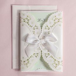 Wholesale Ivory Ribbon Wedding Invitations - Wholesale-Laser Cut Wedding Invitations Ivory Flora Party Invitation Cards with Bowknot Ribbon Wedding Favors Birthday Card CW5180