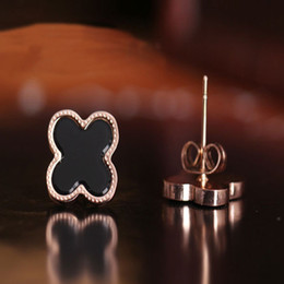 Wholesale Cheap Star Earrings - The star of the same paragraph, titanium plated in Rose Gold Earrings quatrefoil ultra cheap quatrefoil shell earrings