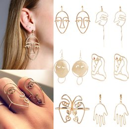 Wholesale Simple European - 2017 new European and American jewelry retro simple personality exaggerated earrings alloy plating hollow face earrings wholesale
