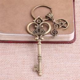 Wholesale Antique Bronze Charms Crown - 2 pcs lot Metal Antique Bronze Key Charm Key Ring DIY Metal Crown Key Pendant Jewelry Making C0249