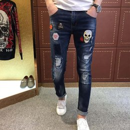Wholesale Skull Jeans Men - Wholesale- European brand rose embroidery cloth skull hole needle slim feet micro elastic jeans male Metrosexual trousers quality