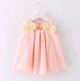 Blusa sin mangas rosa online-Vestido lindo de la muñeca del estilo de la blusa del bebé Baby Girl Lovely Pink Bow Tutu Falda Top 100% algodón Niños Ropa