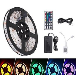 Wholesale 12v Leds Strips - Led Strips Waterproof 5M 300 Leds SMD 5050 RGB lights led strips 60 leds M +24Key IR Remote Controller + 12V 5A power supply