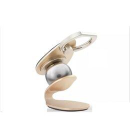 Q mobiltelefon online-Alle metall 360 Grad Q Ring schnalle Multifunktions Universal Autotelefonhalter Magnettelefon Auto Handyhalter Stehen