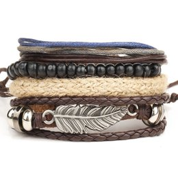 Wholesale Bohemian Feather Cuffs - 120pcs New angel wings feather alloy multi-layer bracelet wooden beads braided bead wax rope bracelet Personalized Adjustable Bracelet