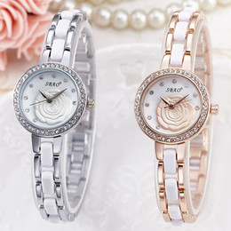 Wholesale Korean Ceramic Watch - The Qixi Festival gift selling Korean fashion lady Taobao ceramic watch small diamond dial quartz watch waterproof trayful