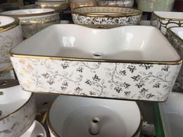 Wholesale Wood Bathroom Cabinet - Oval shape bathroom basin Super beautiful design plating electroplated ceramic wash basin solid wood bathroom cabinet Artistic Basin