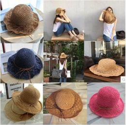 Wholesale Silver Wide Brim Hat - 23 Colors ! Fashion wide Brim summer beach sun hats for women crochet bowknots straw Hats caps seaside holiday sunscreen big foldable hats