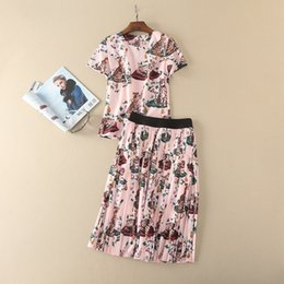 Wholesale Pink Dresses United States - Europe and the United States women's clothing The new summer 2017 Cat cartoon printed short-sleeved T-shirt pleated skirt suit