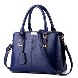 Wholesale Dress Bag Logo - 2017 Ladies Hand Bags Famous Brand Bags Logo Handbags Women Fashion Black Leather pochette Shoulder Bag Women Big Bags Purse
