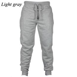 Pantalones de chándal delgados al por mayor-para hombre Pantalones delgados Pantalones Pantalones Hot New Fashion Light Grey Flat desde fabricantes
