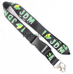 Canada Vent d'automobile JDM Lanyard Keychain Porte-clés d'identification de porte-clés d'identification de chaîne pour téléphone portable Bandoulière noire et verte. Offre