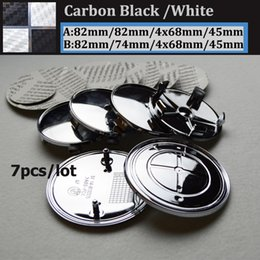 Wholesale Carbon Fiber Steering Wheels - 7pcs lot epoxy carbon fiber black white Badge Front Hood Emblem 82mm+Rear Emblem 82mm+4pcs Wheel Hub Cap 68mm + steering wheel sticker 45mm