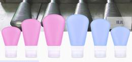 2019 botellas plásticas al por mayor Botellas de viaje líquidas convenientes rellenables con botellas de silicona a prueba de fugas Caja de contenedor exprimible 60 ml 3 colores