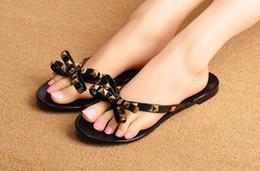 2017 nouvelle marque Europe et US été cool pantoufles nouvelle mode arc sandales sandales de plage décorées avec des rivets ? partir de fabricateur