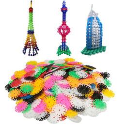 Juguetes de rompecabezas de copos de nieve online-Al por mayor-400PCs Nueva llegada Multicolor Kids Snowflake Building Puzzle educativos juguetes de Navidad ladrillos DIY montaje de juguetes clásicos