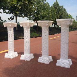 Columnas de suministros de boda online-Diseño de flor hueca Columnas romanas Color blanco Pilares de plástico Cita Apoyos de la boda Evento Decoración Suministros 10 unids / lote