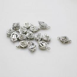 Argentina 10 UNIDS Caliente al por mayor Snap Rose botón Metal accesorios de BRICOLAJE para el Accesorio para Collar Pulsera Mecanizado de piezas de metal plateado Suministro
