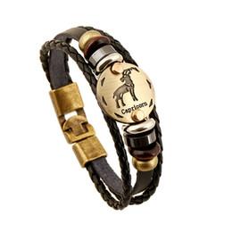 Großhandel sternzeichen armbänder online-Großhandels - Bronzelegierungs-Art- und Weiseschnallen-Tierkreis-Zeichen-Armband-Punkleder-Armband-hölzerne Korn-Schwarz-Gallstone für Mann-Charme-Schmuck