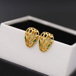 Wholesale Earring Heads - Middle East hot copper gold plated fashionable earrings jewelry purple diamond eyes hollow snake head earring with a suit