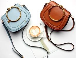 Wholesale sky saddle - Women's Bags. Cowhide. Handbag. Metal ring. Saddle bag. Small. Mini. Genuine leather. Fashion casual bag. Cross Body.Shoulder Bags.