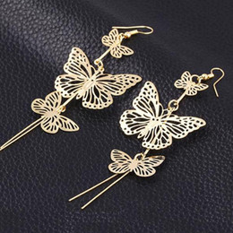 Wholesale Double Tassel Earrings - New Fashion Gold Silver Alloy Double Bow Hollow Flower Jewelry Butterfly Earrings Long Tassel Earrings Brincos Compridos 2016