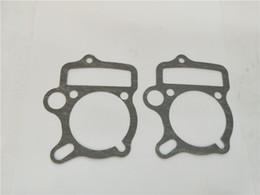 Canada vente en gros pour les hots ventes moto moteur accessoires cylindre culasse jeux cylindre bloc joint pour honda c110 Offre