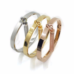 Wholesale Fitness Cuffs - Wholesale- Fashion Gold Plated Women Love Jewelry Charm Fitness Bracelet Hand Cuff Titanium Punk Ladies Bangle Charm Bracelet with Tassels