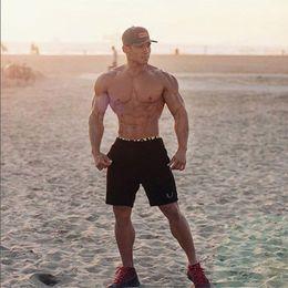 Sportwear Homens Muscle Gyms Shorts Musculação Algodão Comprimento Calças Casual FitnessCalças Moda Marca Runner Calças Curtas Mens Moda de