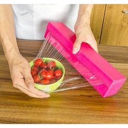 Wholesale candy films - Hot Sale Plastic film cutter Candy color kitchen gadget Hot Film Cutter Plastic Food Wrap Dispenser Foil Wax Paper Cutter