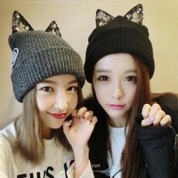 2019 schwarze schädelhüte Frauen Acryl Katze Ohren stricken schwarzen Beanie-Hut warme Winterhüte für Frauen Einfarbige Beanie-Schädel-Kappen-Katzenohr-Hut LA339 rabatt schwarze schädelhüte