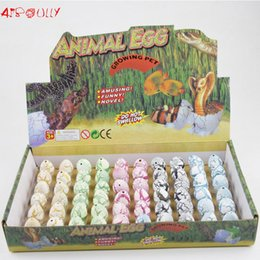Wholesale Eggs For Hatching - Wholesale- 60pcs lot Colorful Novelty Gag Toys Children Toys Cute Magic Hatching Growing Dinosaur Eggs For Kids Educational Toys Gifts