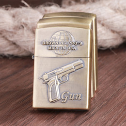 encendedores de pistola Rebajas Al por mayor- El viejo encendedor de queroseno Pistola Xinqite personalidad creativa retro en relieve encendedor