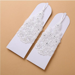 Wholesale Beaded White Wedding Gloves - 2017 white Lace Bridal Gloves Crystal Beaded Wedding Glove Short Wedding Accessories Gloves for Brides Fingerless Fast Shipping In Stock