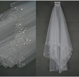 Wholesale wedding veils beaded edge - Shiny Handmade Beaded Sequined Edge Wedding Veils 2 Layers Short Tulle White Ivory Bridal Veils 2017 Best Selling