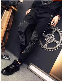 Wholesale Footing Design - Wholesale- spring hot drilling skull brand men's casual pants men's dark thin feet design top quality 874