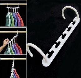 Bolsas de tela online-500 bolsas Space Saver Wonder Magic Hanger Organizador para armarios Wonder Hanger para sus bolsas Cinturones Telas Lazos
