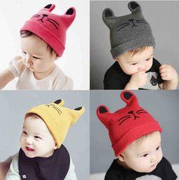 Bebé sombreros gatito hilados de lana otoño invierno gorros de punto  regalos de la muchacha sombreros lindo lindo sombrero elástico caliente 746f0b4c71c