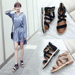 Sandalias romanticas online-Moda mujer primavera y verano cabeza redonda sandalias planas correas cruzadas zapatos de mujer romántica sandalias de moda