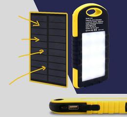Wholesale External Backup Battery Charger Light - 5000mAh universal Dual USB Solar Power Bank Charger External Backup Battery With LED Light Retail Package for iPhone 7 ipad samsung