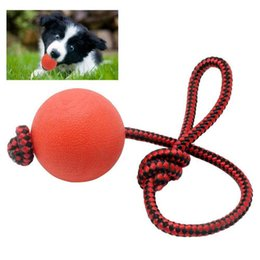 Wholesale Dog Ball Rope Toys - 2pcs lot New Red Solid Rubber Chew Training Ball Toys Tooth Cleaning Puppy Pet Dog Cat With Rope Handle