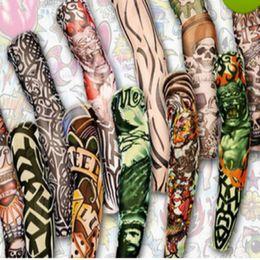 disegni manica braccio tatuaggio Sconti 12pcs mescolano l'elastico provvisorio libero di trasporto del tatuaggio del manicotto 3D disegni artistici le calze della gamba del braccio del corpo tatoo freddo