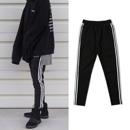 Wholesale high quality pants - dongguan_wholesale in stock High Quality Mens Kanye West Jogger Sweatpants Male Justin Bieber High Street Hip Hop Pants Skinny Jogger Trouse