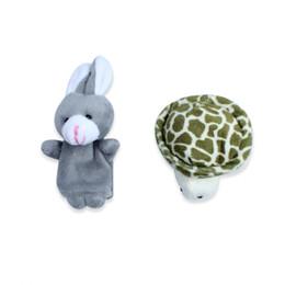2PCS / set Hada divertida de la tortuga del regalo del partido del cabrito de la historieta del juguete del bebé de la muñeca del paño de las marionetas divertidas del dedo
