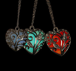 Wholesale Heart Shaped Sweater - 2017 Heart Shaped Pendant Necklace Heart Hollow out Luminous Pendants Necklace for Ladies Sweater Necklace Glow in Dark Hot Sale