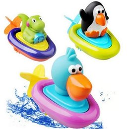 Wholesale Doll Wind Up Toy - Wholesale- Top quality Pull and go boat bath toy baby backguy Play in water clockwork baby toy swim water toys children Wound-up Doll gift