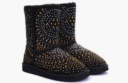 Botas de nieve mujer diamante online-La marca de diseñador de moda remaches botas de nieve botas de invierno cálido botas de nieve de las mujeres Diamante